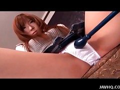 Fashionable Japanese girl vibrated by toy