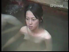 Young nude Asians in the public tub are sumptuous